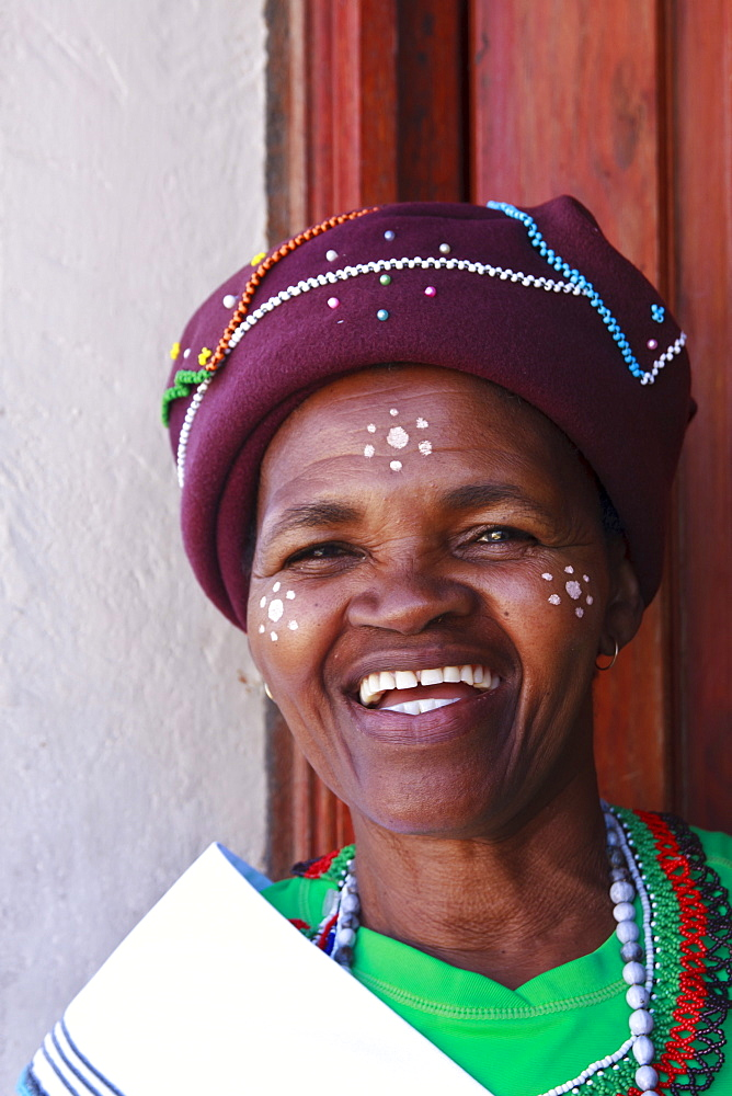 Resident in traditional dress at her house, Langa Township, Cape Town, South Africa, Africa