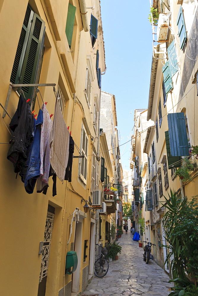 Narrow street with washing, Old Town, Corfu Town, UNESCO World Heritage Site, Corfu, Ionian Islands, Greek Islands, Greece, Europe