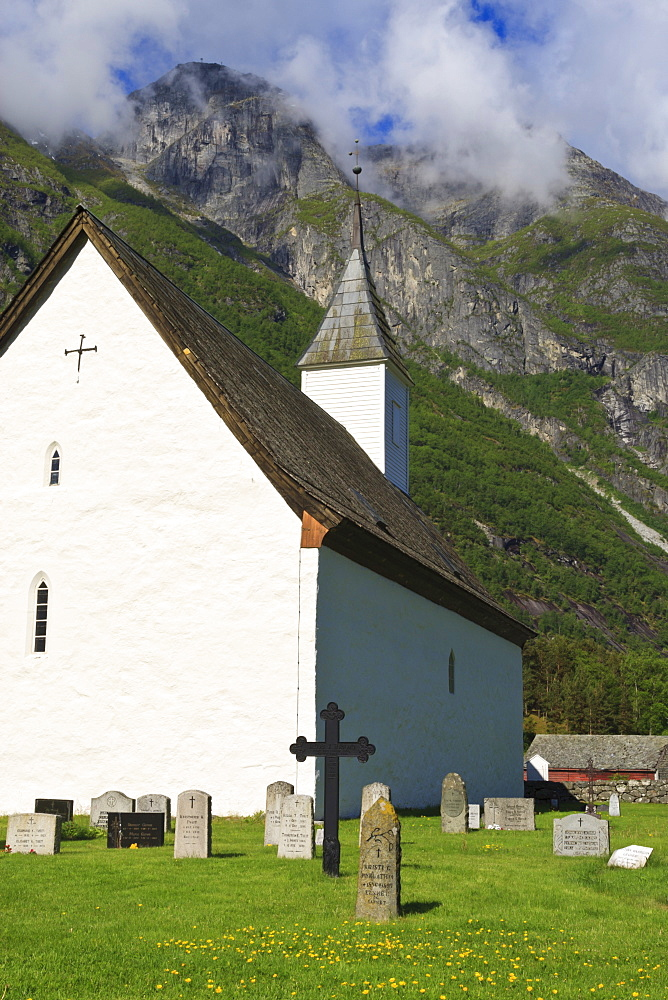 Old Eidfjord Church and mountains, white stone church built in 1309, Eidfjord, Hordaland, Hardanger, Norway, Scandinavia, Europe