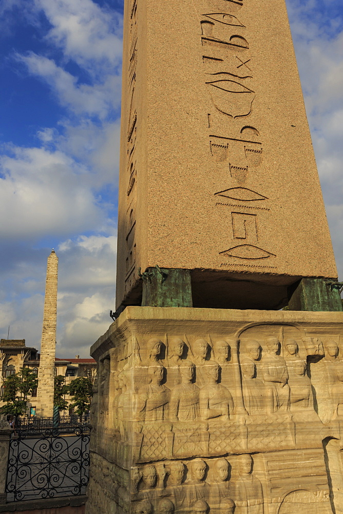 Egyptian Obelisk hieroglyphics and Brazen Column, Hippodrome, August early morning, Sultanahmet District, Istanbul, Turkey, Europe