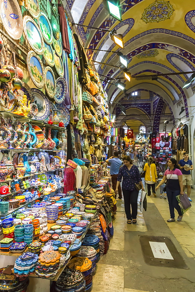 Shoppers with bags on a Friday afternoon in street with decorated ceiling and pottery stall, Grand Bazaar, Istanbul, Turkey, Europe - 1167-559