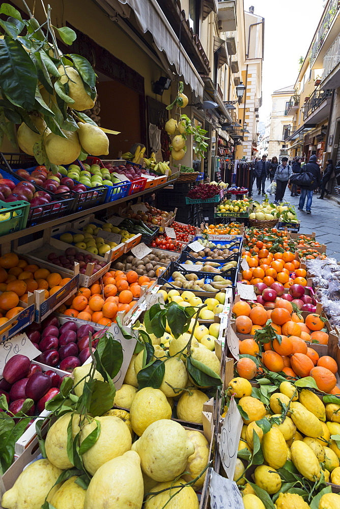 Fruit, including local lemons and oranges, displayed outside a shop in a narrow street, Sorrento, Campania, Italy, Europe