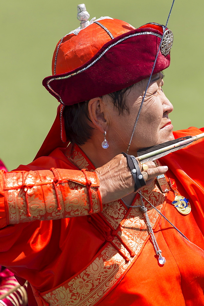 Lady archer takes aim, National Archery Tournament, Archery Field, Naadam Festival, Ulaan Baatar (Ulan Bator), Mongolia, Central Asia, Asia