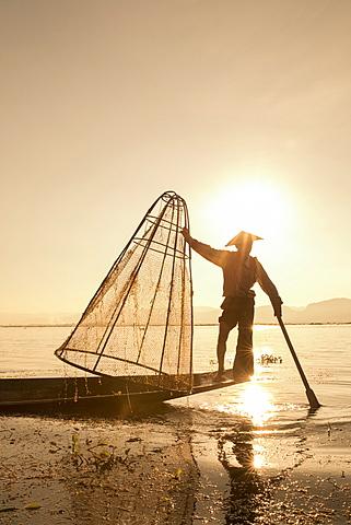 Intha leg rowing fisherman at sunrise, Inle Lake, Nyaung Shwe (Nyaungshwe), Shan State, Myanmar (Burma), Asia - 1170-149