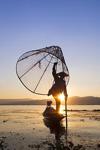 Intha leg rowing fisherman at sunrise, Inle Lake, Nyaung Shwe (Nyaungshwe), Shan State, Myanmar (Burma), Asia - 1170-154