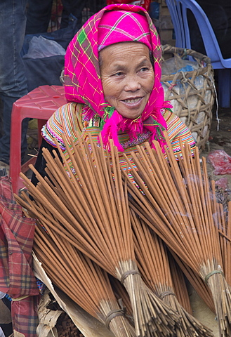 Woman from Flower Hmong ethnic group selling incense at Bac Ha market, Sapa region, Lao Cai Province, Vietnam, Indochina, Southeast Asia, Asia - 1170-170