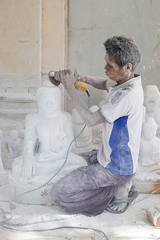 Man covered in white marble dust using angle grinder to make Buddha statue, Stone carvers district, Amarapura, near Mandalay, Myanmar (Burma), Asia - 1170-178