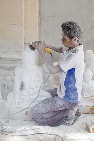 Man covered in white marble dust using angle grinder to make Buddha statue, Stone carvers district, Amarapura, near Mandalay, Myanmar (Burma), Asia