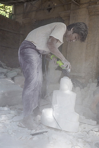 Man covered in white marble dust using angle grinder to make Buddha statue, Stone carvers district, Amarapura, near Mandalay, Myanmar (Burma), Asia - 1170-179