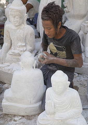 Man covered in white marble dust using angle grinder to make Buddha statue, Stone carvers district, Amarapura, near Mandalay, Myanmar (Burma), Asia - 1170-181