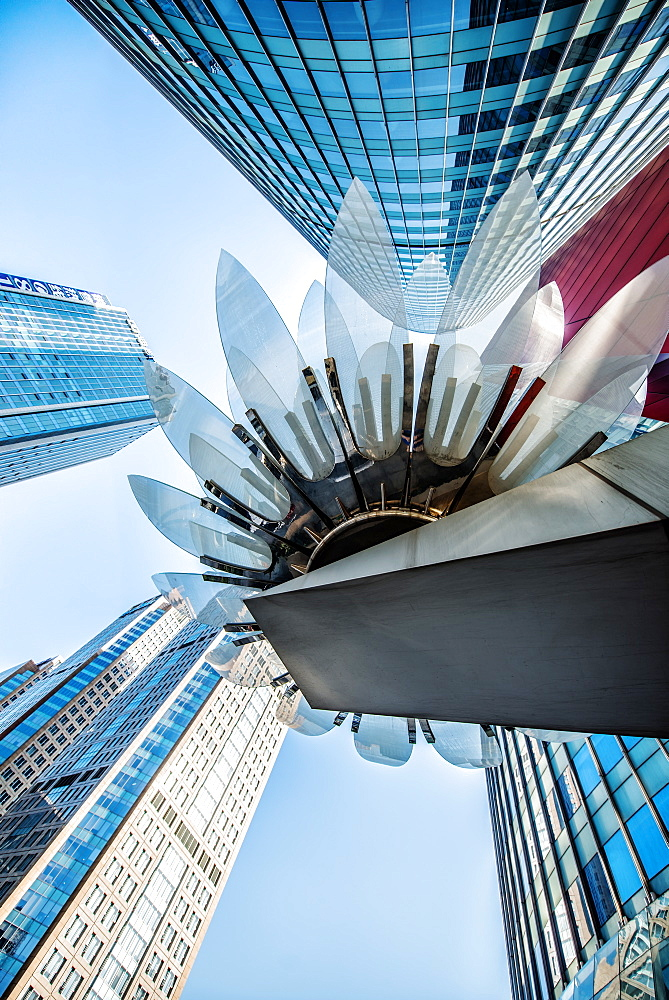 Glass and metal Lotus installation in front of HSBC Bank with surrounding new skyscrapers in Jianggan district, Hangzhou, Zhejiang, China, Asia