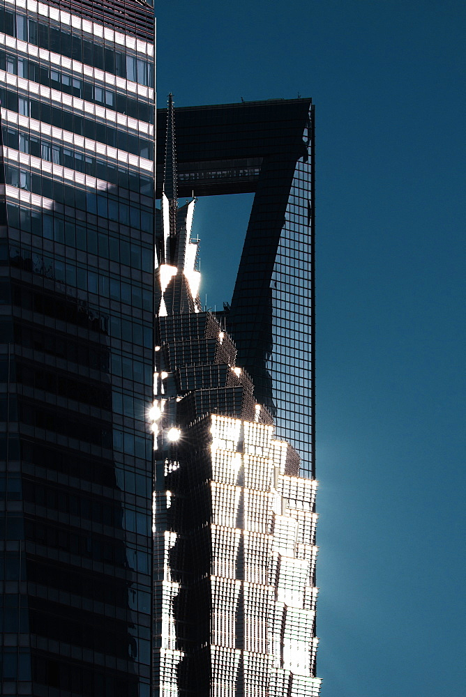 Sunlight reflected off skyscrapers in Pudong district, Shanghai, China, Asia
