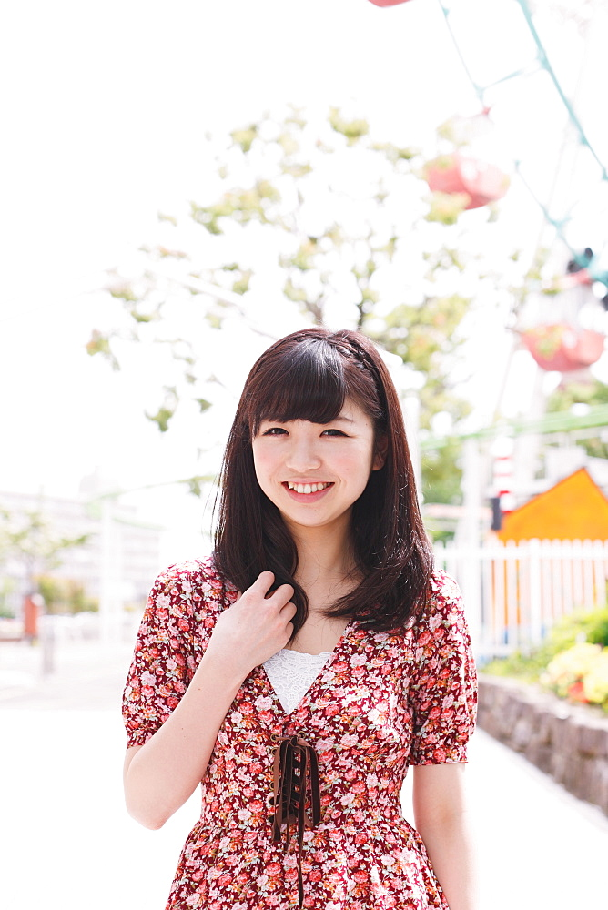 Portrait of a Japanese girl at an amusement park