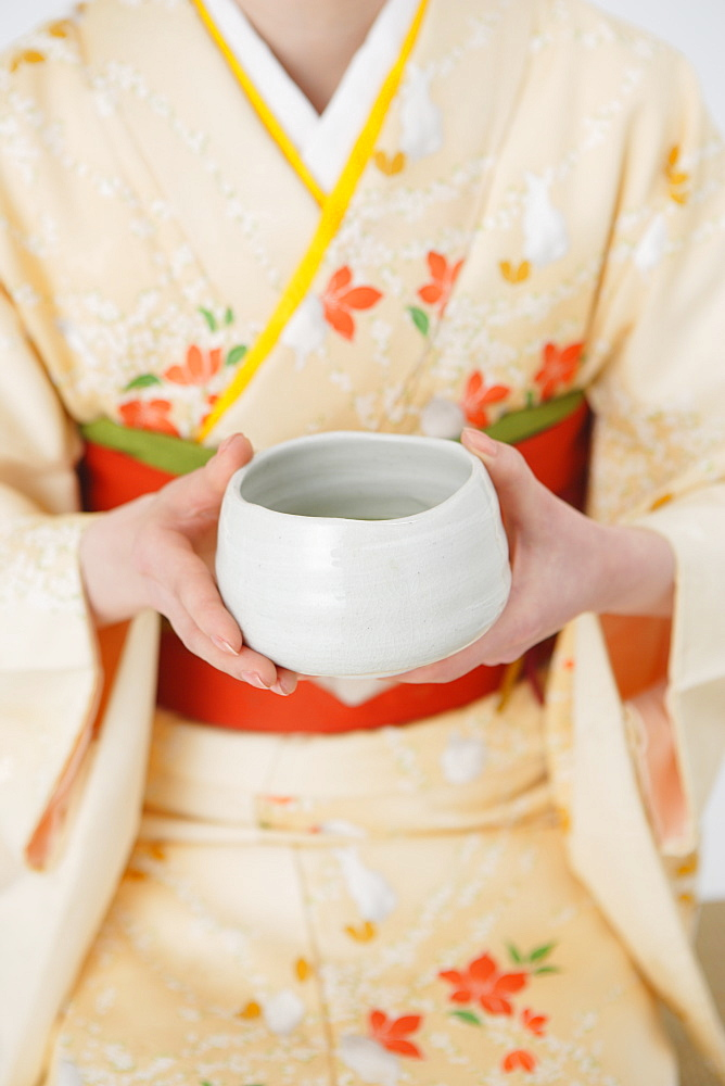 Woman Holding Tea Bowl