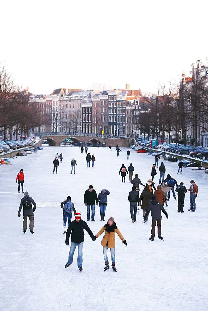 People ice skating in Amsterdam, Netherlands