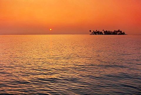 Sunrise over palm island, Tobacco Reef, Belize