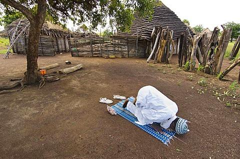 Muslim villager praying, Fongoli, Senegal