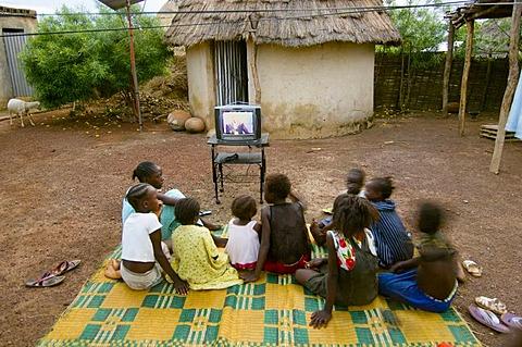 Children watching T.V, Kedougou, Senegal