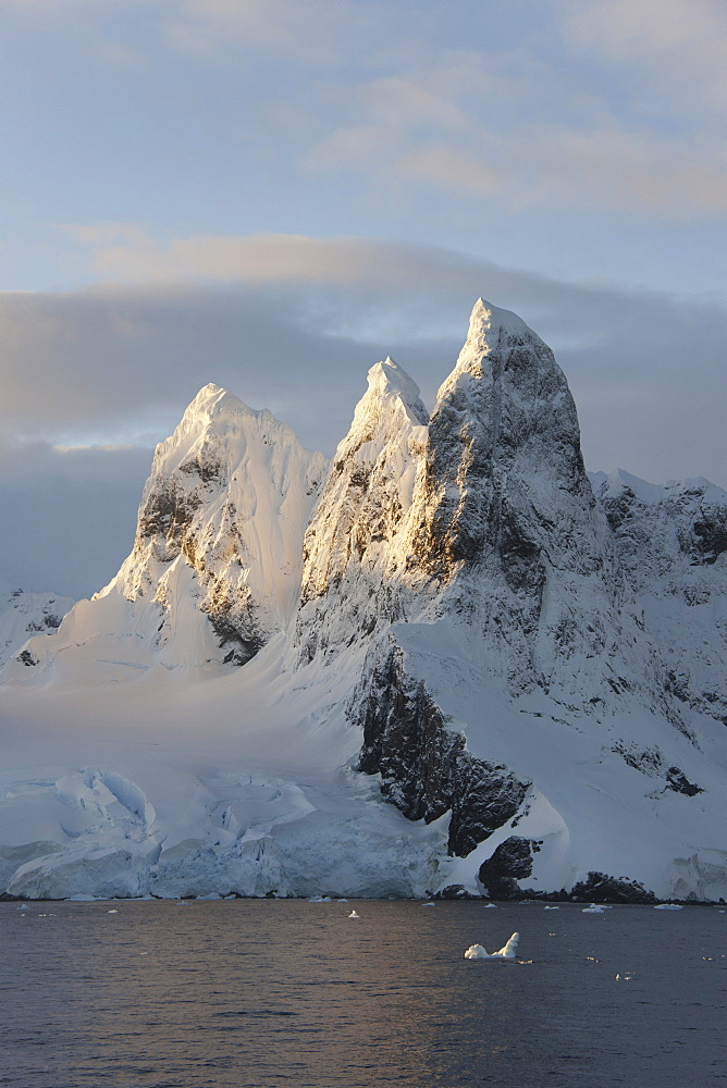 Sunrise on the mountain tops at the north entrance to the Lemaire Channel along the Antarctic Peninsula, Lemaire Channel, Antarctic Peninsula