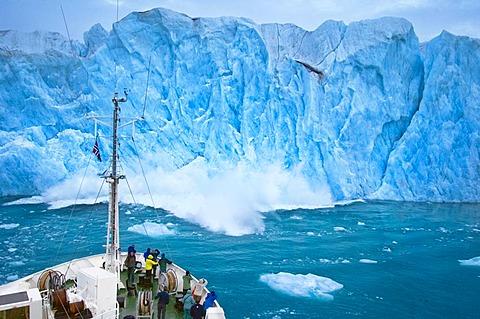 Tourists watching calving of Monaco Glacier, Svalbard, Norway