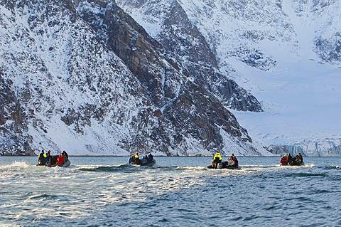 Tourists exploring coastline near Scoresby Sound, East Greenland
