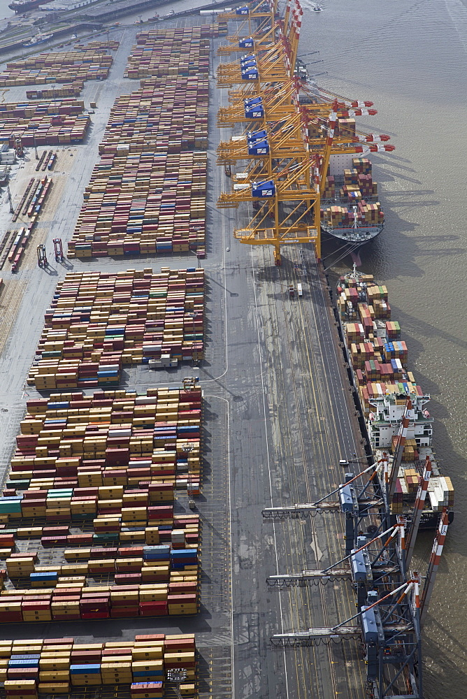 Elevated view of cargo containers and boat at port in Bremerhaven, Bremen, Germany