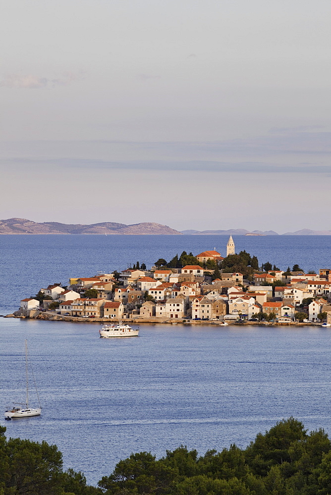 View of Primosten town and mountains on the horizon of Adriatic sea in Croatia