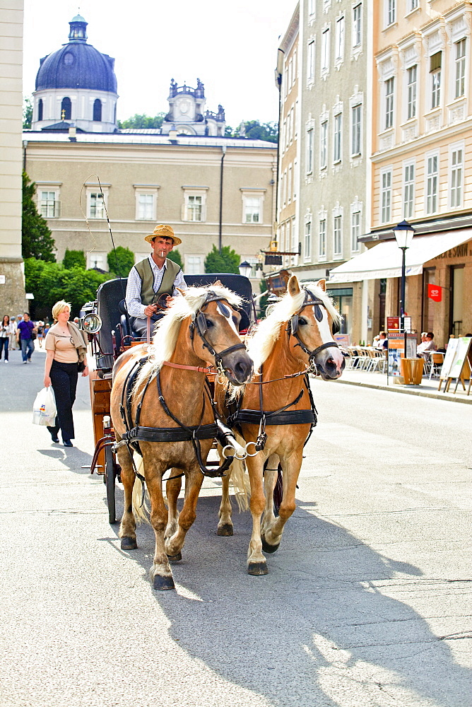 Man sitting on horse carriage, Salzburg, Austria