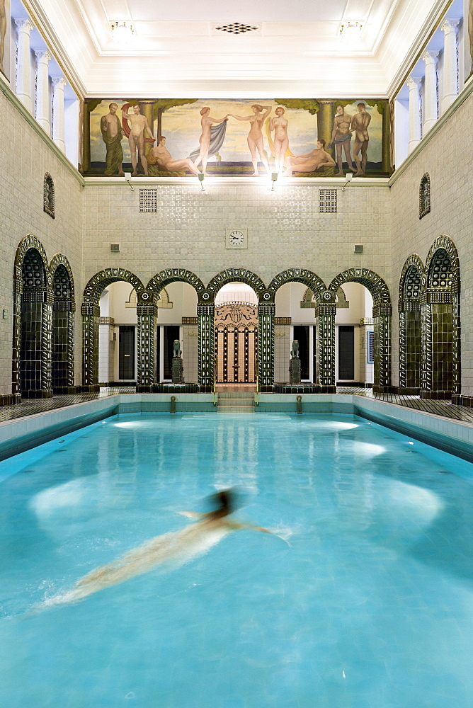 Woman swimming in Emperor Frederick swimming pool, Wiesbaden, Hesse, Germany - 1175-248