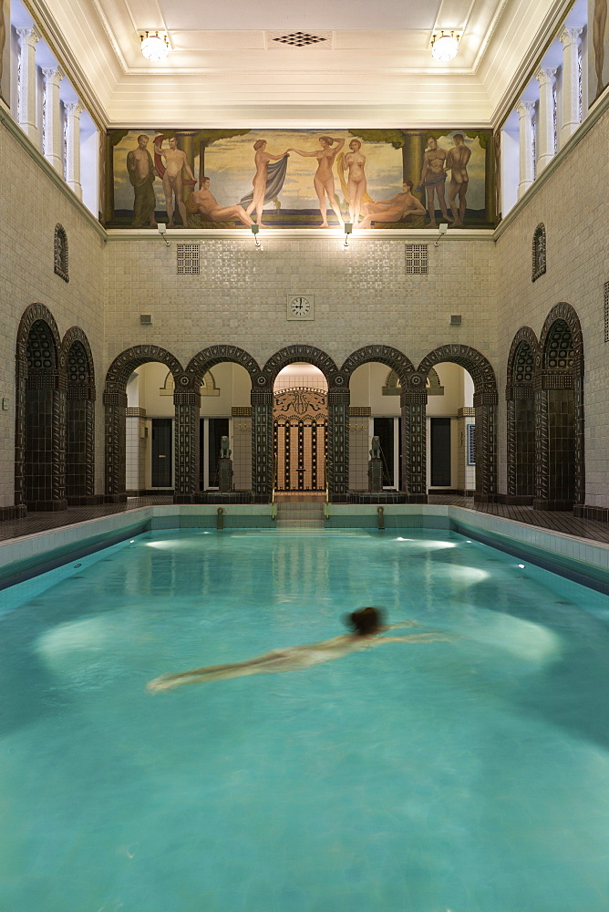 Woman swimming in Emperor Frederick swimming pool, Wiesbaden, Hesse, Germany