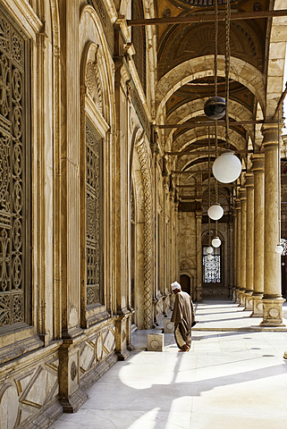 Man at courtyard of Muhammad Ali Mosque, Cairo, Egypt