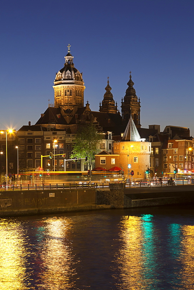 View of St. Nicholas and Schreierstoren at night, Amsterdam, Netherlands