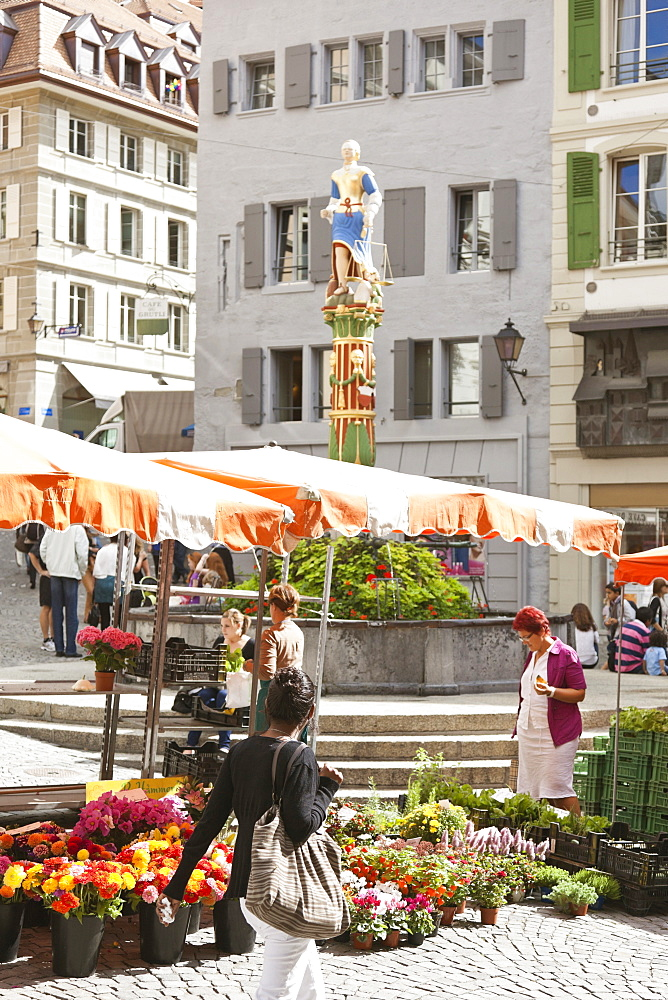 Market place with justice fountain at Place de la Palud, Lausanne, Switzerland