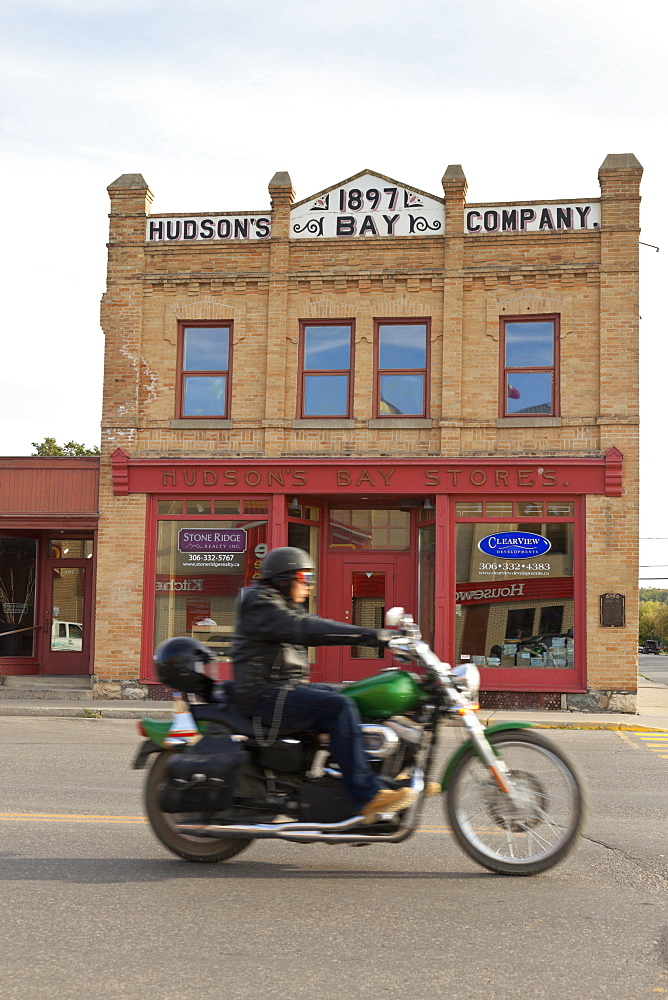 Biker in front of Hudson's Bay Company Store in Fort Qu'Appelle, Saskatchewan, Canada