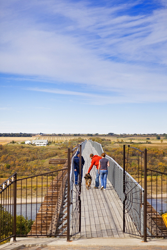 People walking on bridge in Saskatchewan, Canada