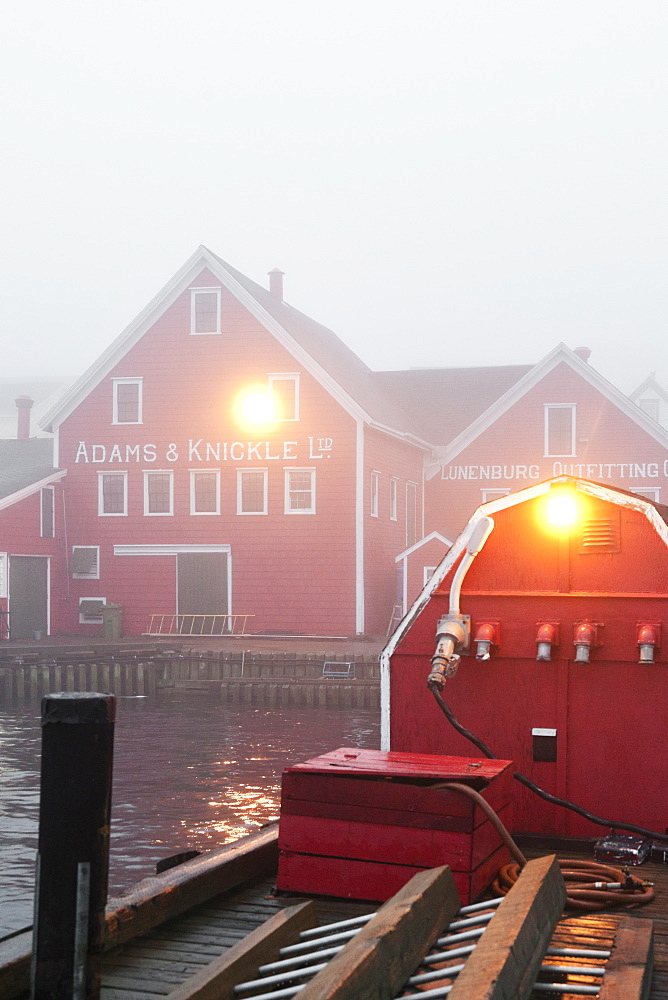 Fog in morning light at Lunenburg Harbour, Nova Scotia, Canada