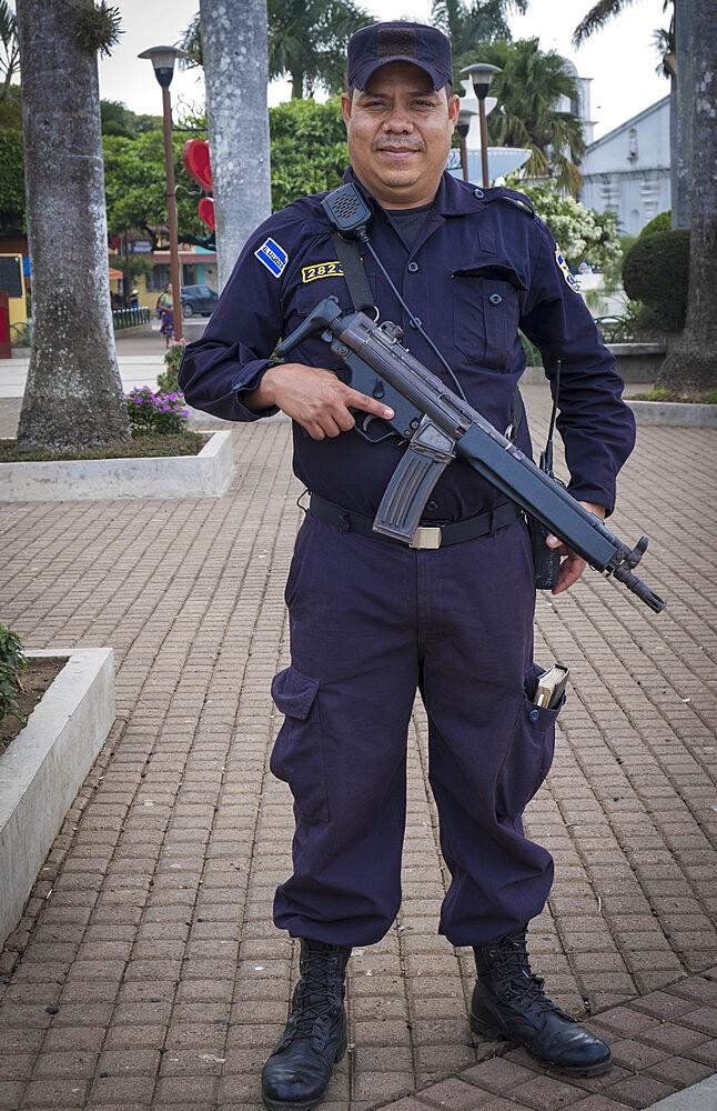 An armed policeman in El Salvador, Central America - 1176-1016