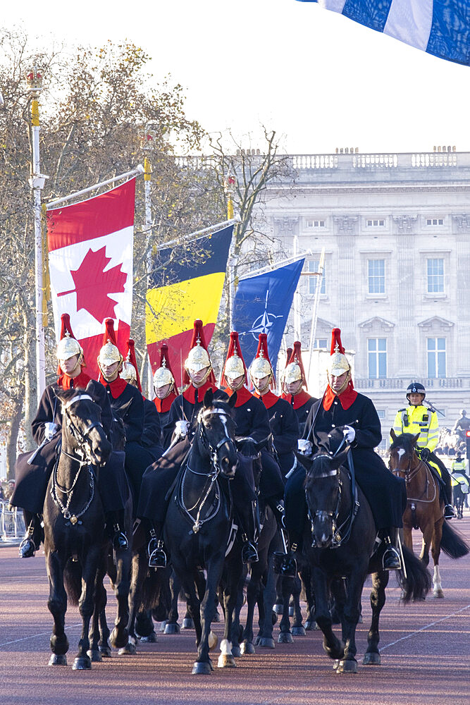 Guardsmen of the Blues and Royals regiment of the Queen's Life Guards riding along the Mall in front of Buckingham Palace