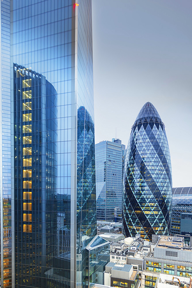 The City of London financial district skyline showing the Scalpel building (52-54 Lime Street) and the Gherkin (30 St. Mary Axe)