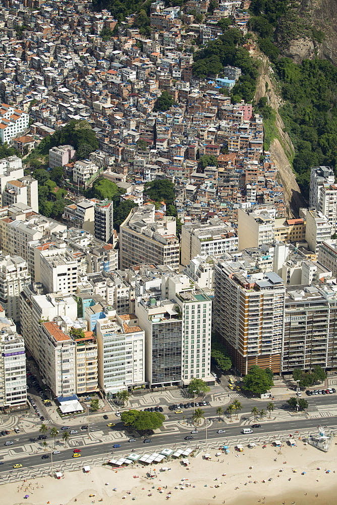 Copacabana Beach, neighbourhood and the Morro da Humaita favela behind, Rio de Janeiro, Brazil, South America