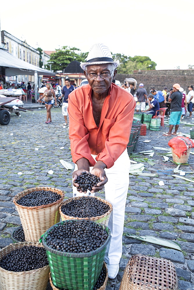 A man selling Acai berries at the morning market, Belem, Para, Brazil, South America