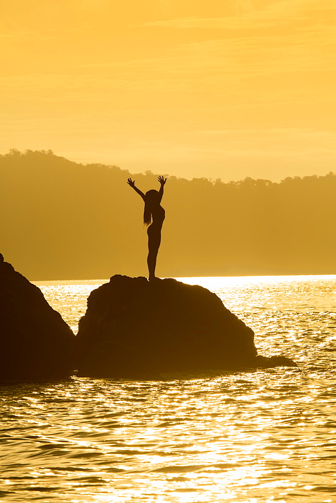 A young woman performing yoga, Puntarenas, Costa Rica, Central America