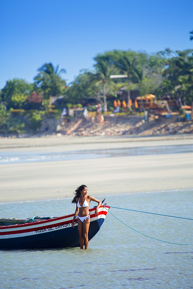 A young woman on the beach in Jericoacoara, Ceara, Brazil, South America