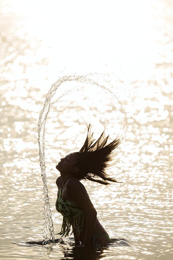 A young Borari indigenous woman swimming in the Amazon, Alter do Chao, Para, Brazil, South America