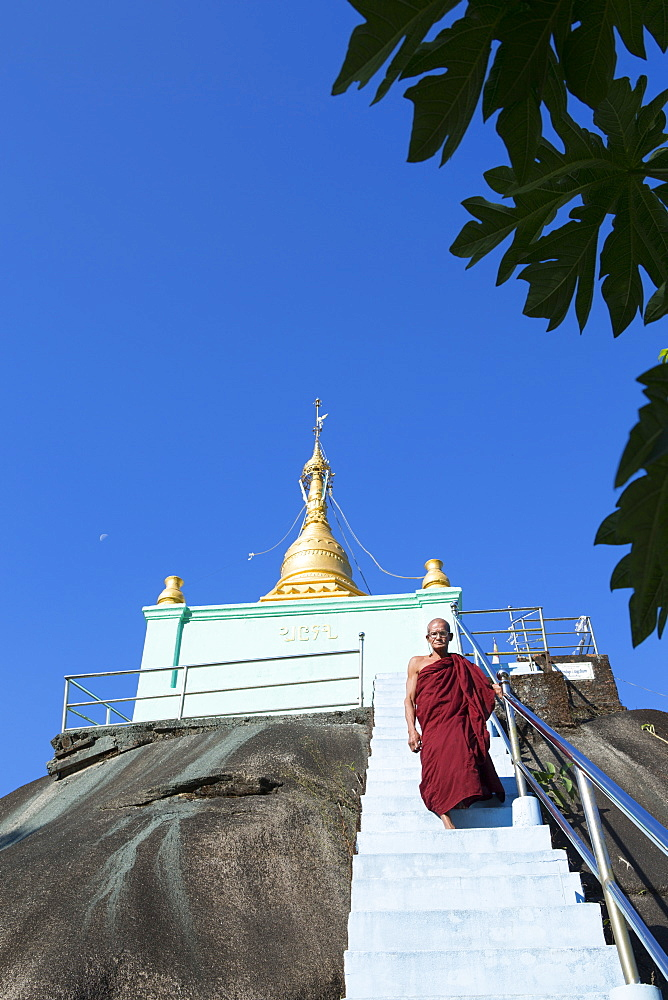 Giant boulder topped by a golden stupa looked after by a buddhist monk, Dawei, Tanintharyi, Myanmar (Burma), Southeast Asia