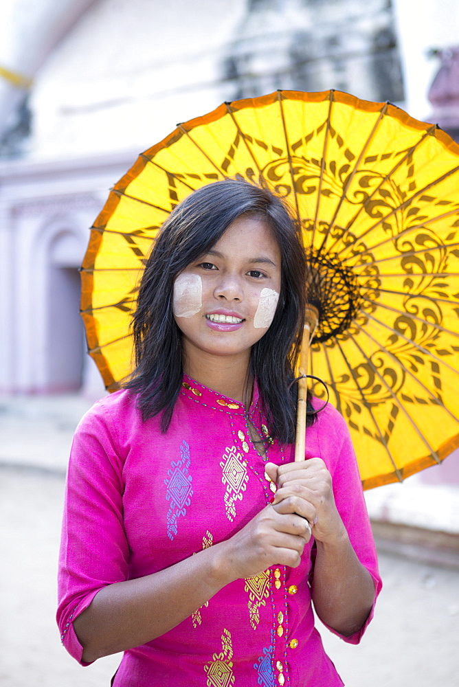 A local girl with a traditional paper sunshade umbrella and thanaka face paint, Monywa, Sagaing, Myanmar (Burma), Southeast Asia - 1176-356