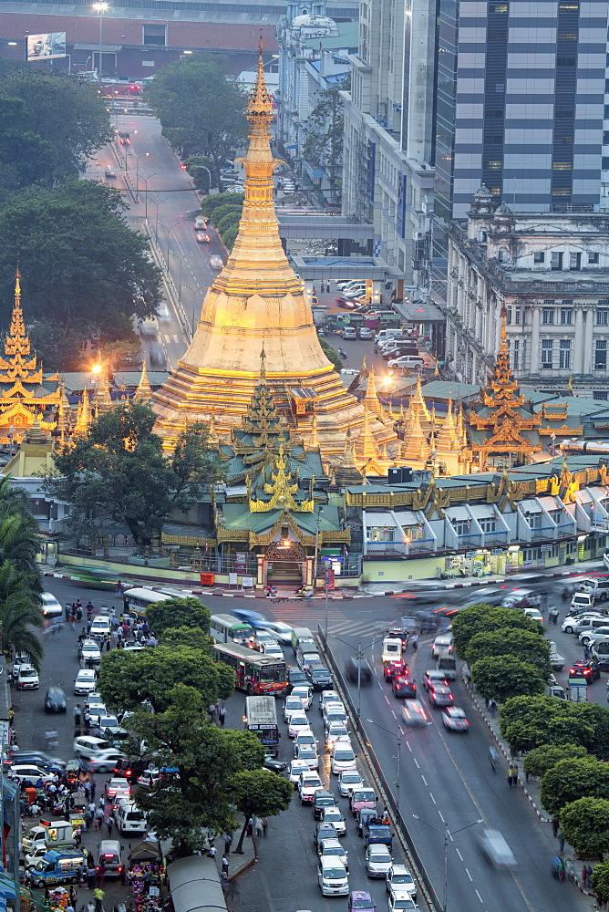 The Sule Paya pagoda in rushing traffic, downtown Yangon, Myanmar (Burma), Southeast Asia