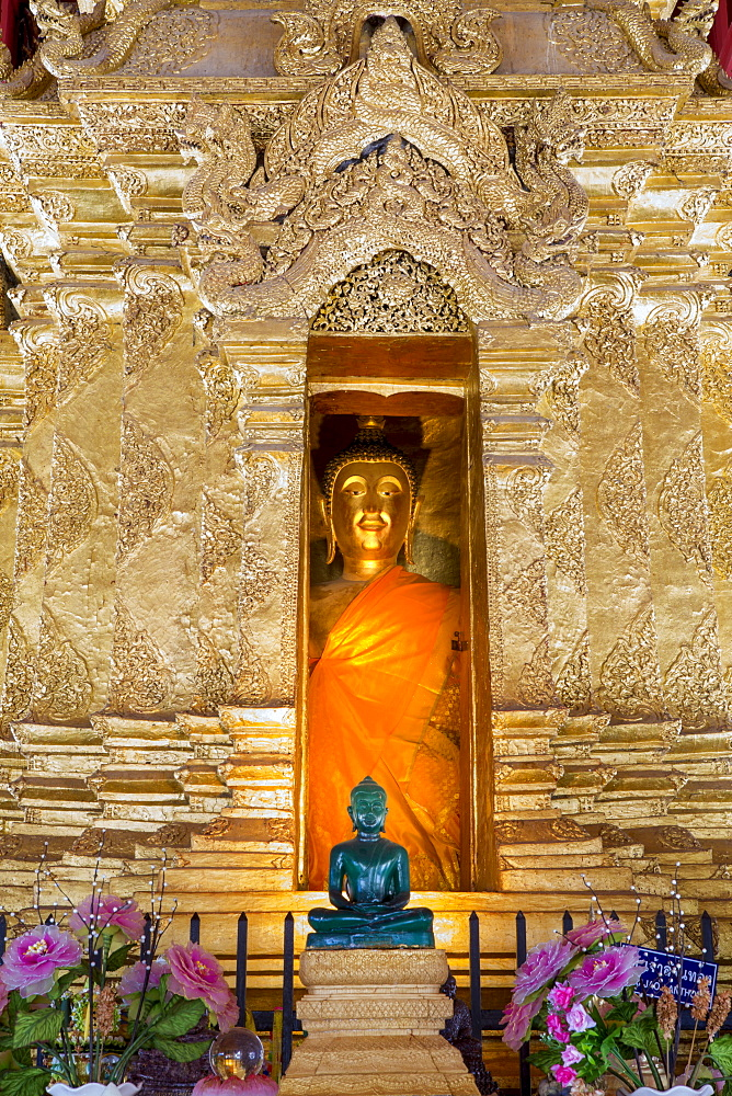 Emerald Buddha and golden Buddha in the main bot of historic Wat Phra That Lampang Luang temple, Lampang, Thailand, Southeast Asia, Asia