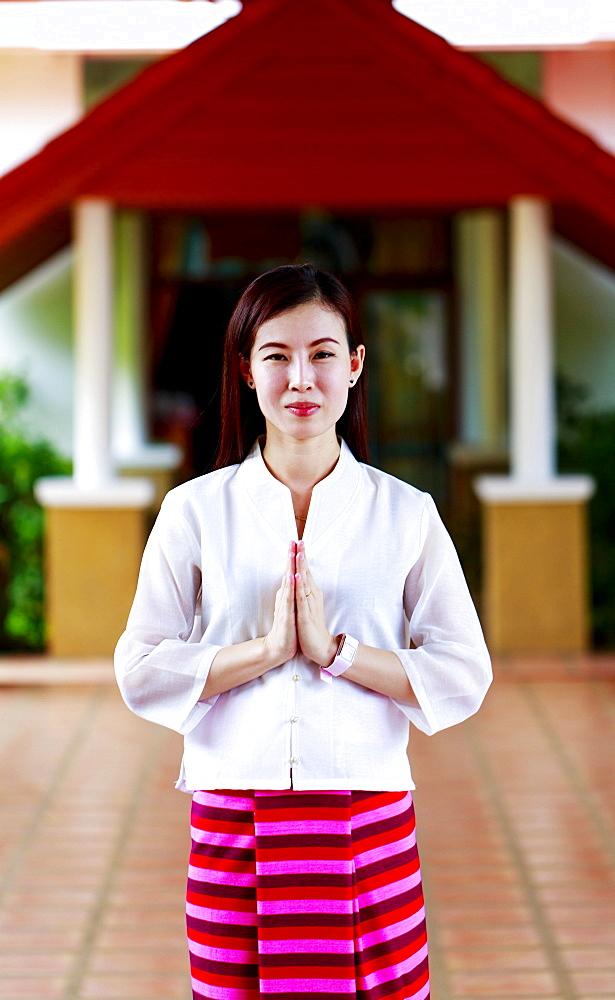 Woman making a Thai Wai salute in Lamphun, Thailand, Southeast Asia, Asia