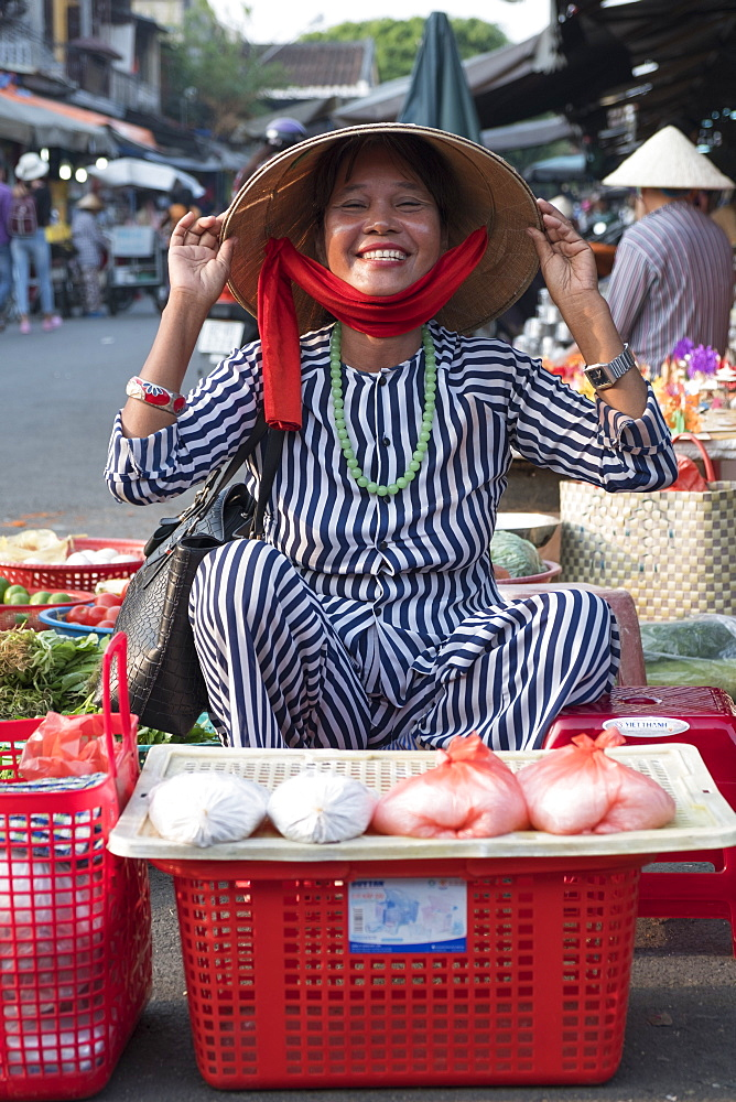 A street market seller in Hoi An, Vietnam, Indochina, Southeast Asia, Asia